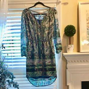 Stunning patterned, long-sleeved dress